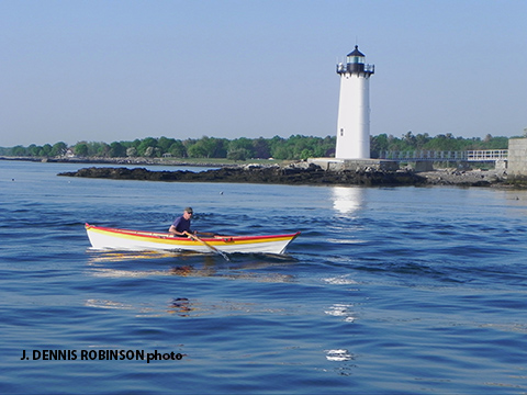 Dan O'Reilly passing Fort Constitution and lighthouse in New Castle / J Dennis Robinson photo