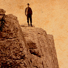 Man standing on Cliff at Star Island