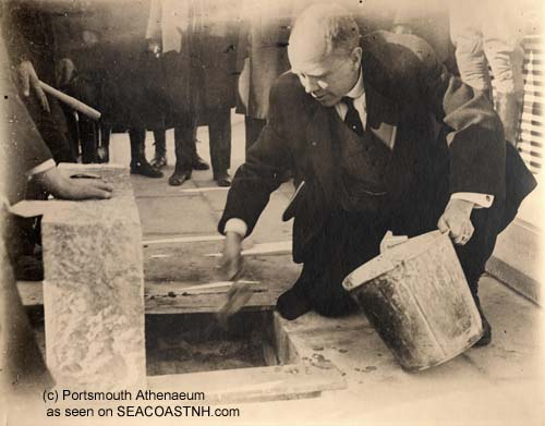 Gov. Percival Baxter cementing a plaque at the dedication of Memorial Bridge over the Piscataqu River in 1923