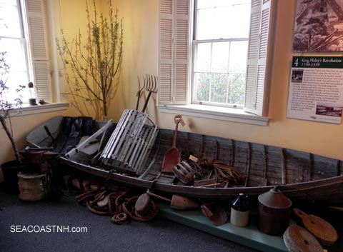 Weathered skiff in UNder the Shoals exhibit /SeacoastNH.com