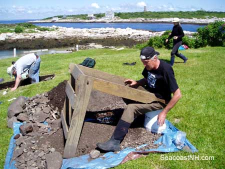 Prof Nathan Hamilton sifting soil on the Isles of Shoals in 2009 / J. Dennis Robinson photo