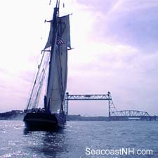 Tall ship approaching Memorial Bridge linking NH and Maine by J. Dennis Robinson / SeacoastNH.com