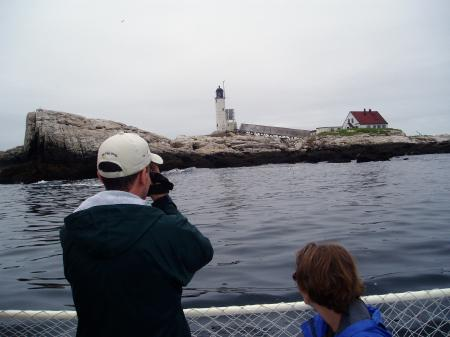 Visitors get a close look at White Island lighthouse aboard the Uncle Oscar