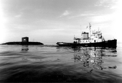 USS Albacore towed