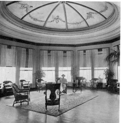 Turn of the century photo with female guest in lounge area under dome / SeacoastNH.com Early Images